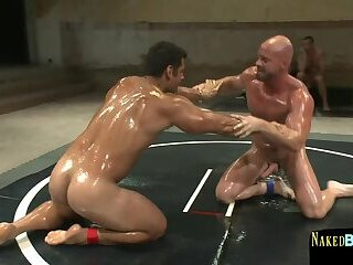 Wrestling muscle oiledup and grappled