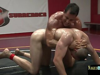 Naked muscular hunks wrestle and roll around
