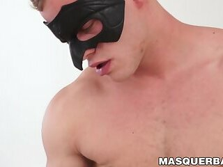 Masked stud gets his fat cock sucked by beautiful babe