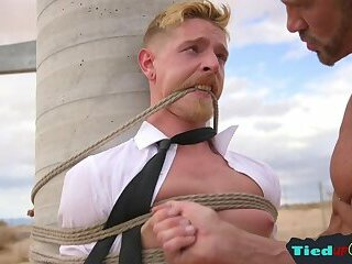 Handsome stud deepthroating while restrained