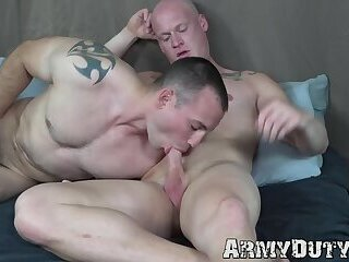 Tattooed bald soldier barebacked by hunky gay comrade