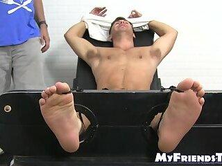 Handsome hunk endures tickling torment from deviant mature