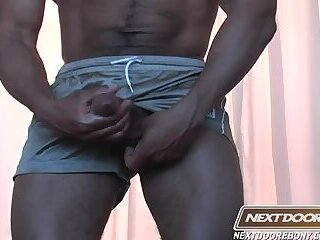 Big black dick keeps popping out of his shorts