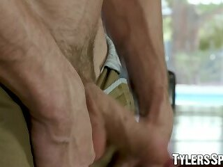 Stud pulls on cock and moans after licking his big biceps