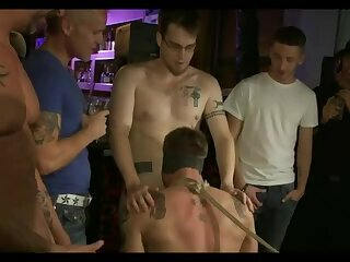 Blindfolded and bound in a crowded bar