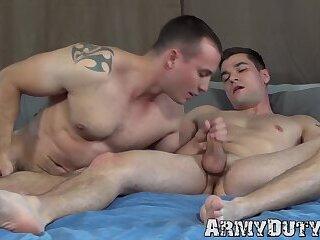 Handsome tattooed soldiers masturbate and bareback fuck