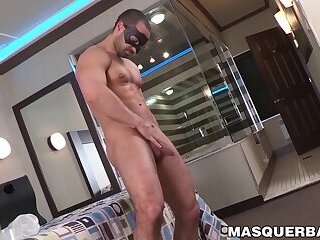 Masked muscular stud masturbates and fucks a fleshlight