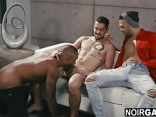 Black on white gay threesome sex during photoshoot