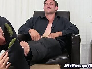 Handsome hunk enjoys himself while his toes are sucked