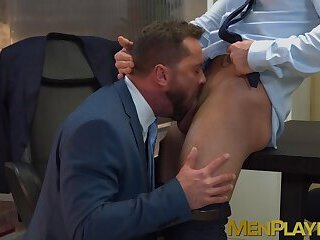 Businessmen stain their office table and equipment with cum