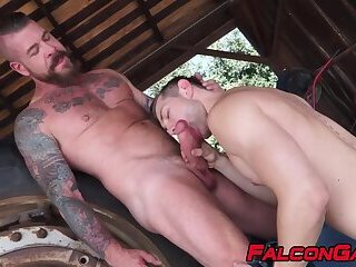 Bearded mature gay anal fucks young athletic homosexual