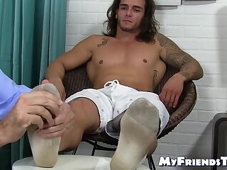 Inked beefcake with long hair enjoys having his toes licked