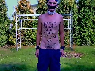 naked slave exposed with body writing outdoor show his caged cock