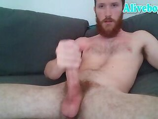 red bearded man stroking his big cock