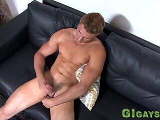 Muscular stud jerking his dick