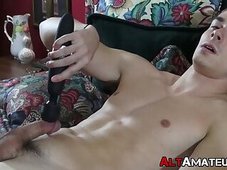 Handsome jock massages his cock and tight ass with vibrator