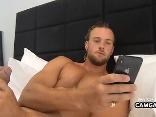 Handsome blond man wanking with his big cock