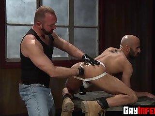 Fisting top Josh West shoves an enormous toy inside studs asshole
