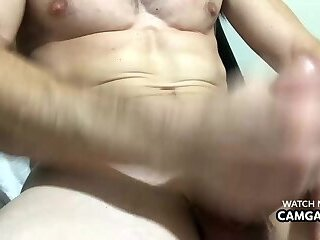 Muscular man cumming in webcam