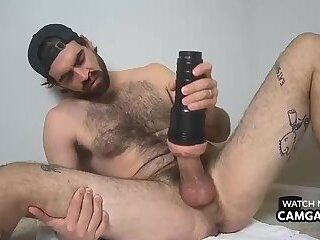 Hairy man jerking off with a fleshlight