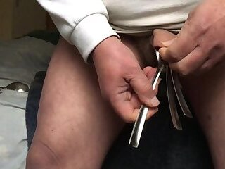 Standing floppy foreskin with: 18 metal spoons