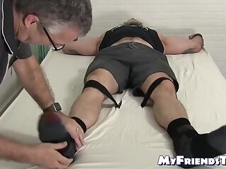 Bound bearded muscular hunk recives body and foot tickling