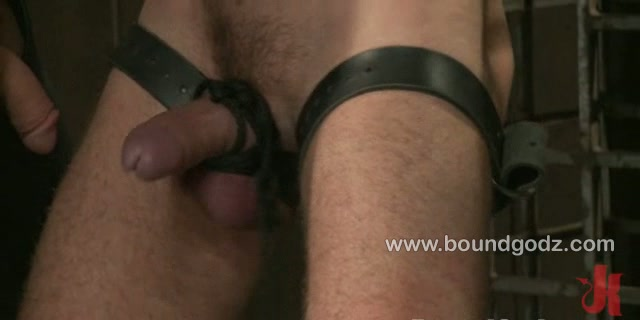 Bad ass cliff jensen is bound in leather straps