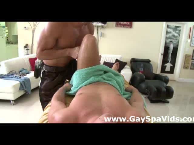 Straight hunk gets hard for gay masseur